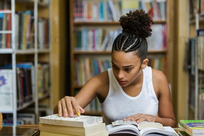 Black african american young girl student studying at the school