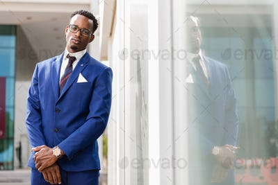 Outdoor standing portrait of a black African American business m
