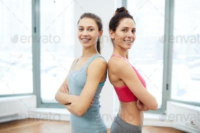 Two Beautiful Women Posing in Gym