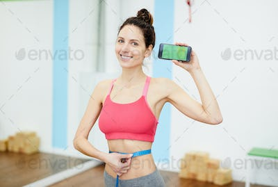 Smiling Woman Presenting Weightloss App