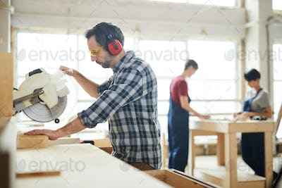 Using circular saw in workshop