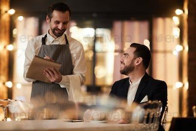 Guest Ordering Food in Restaurant