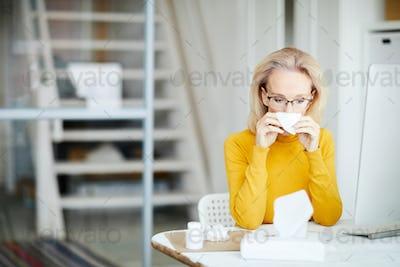 Sick Businesswoman at Work