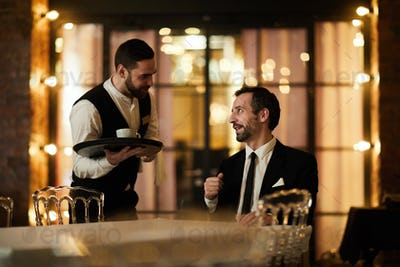 Waiter Bringing Coffee to Client