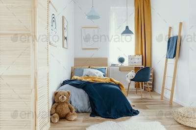 Multifunctional bedroom and workspace interior with bed and desk