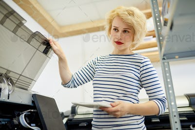 Woman Using Copy Machine