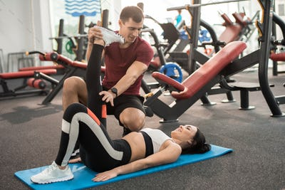 Fitness Instructor Working with Client