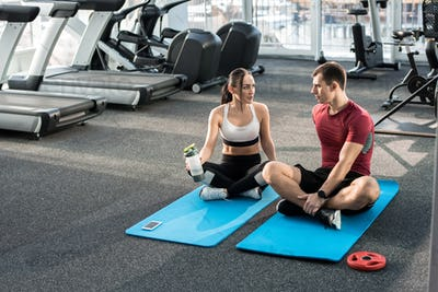 Couple Training Together in Gym
