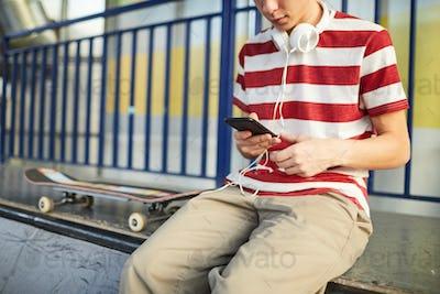 Teen skateboarder chilling