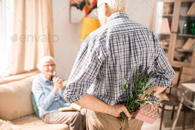 Senior Man Surprising Wife with Present