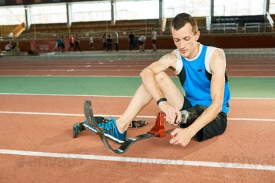 Handicapped Sportsman Putting on  Prosthetic Foot