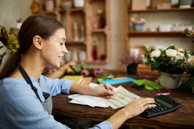 Woman doing Accounting in Shop