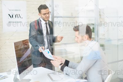 Manager Talking to Employee in Office