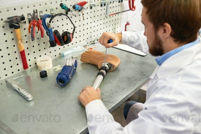 Prosthetist Making Artificial Leg