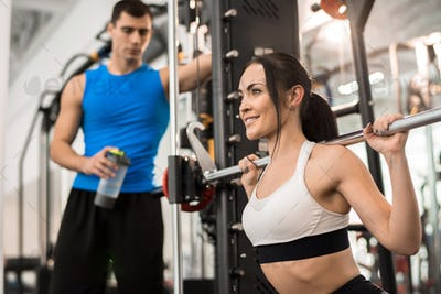Young Woman in Working Out with Barbell