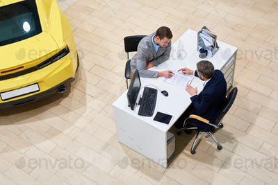 Client Signing Papers to Buy Car