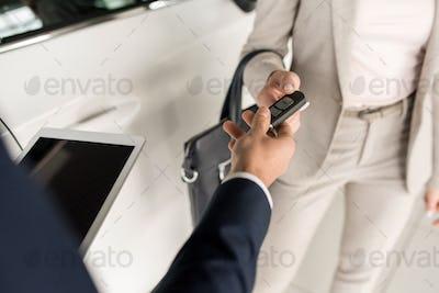 Salesman Giving Car Keys to Client