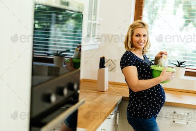 Pregnant woman working in kitchen