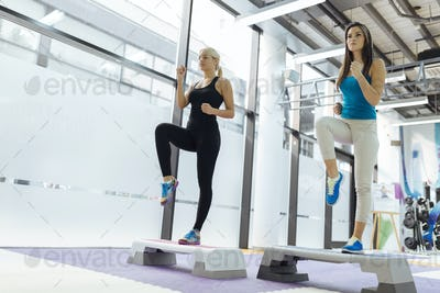 Beautiful women exercising aerobics