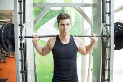 Handsome man training in gym