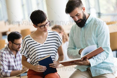 Young woman and man studying for an exam