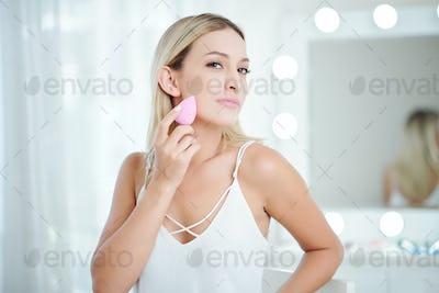 Woman blending foundation