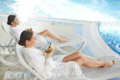 Beautiful Women Relaxing by Pool