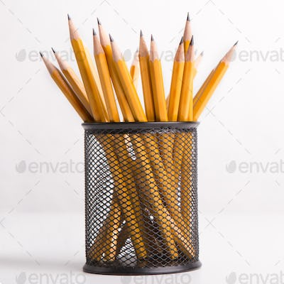 Close up of pencils for drawing in stationery glass on white