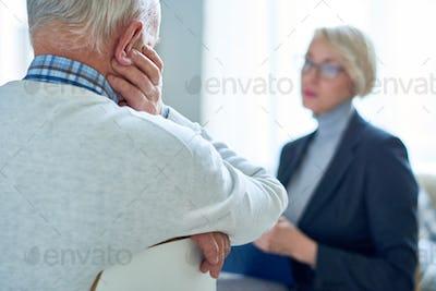 Senior Man Talking to Therapist