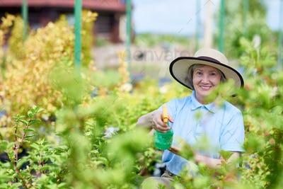 Happy Senior Woman Working in Garden