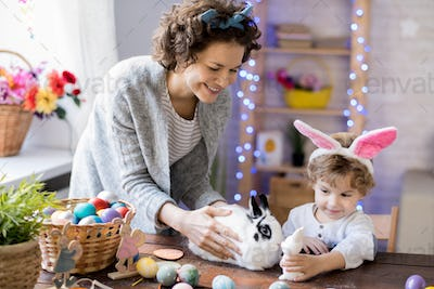 Mother and Son Playing with Easter bunny