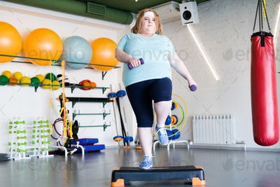 Obese Woman Doing Step Fitness
