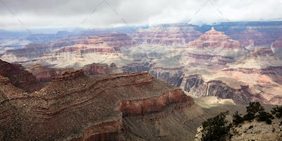 Grand Canyon, Arizona, USA. Overlook of the red rocks, cloudy sky background