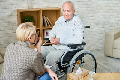 Handicapped Senior Man in Therapy