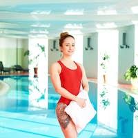 Smiling Sportswoman in Swimming Pool