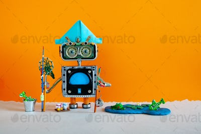 Fishing and vacation Robotic. Robot angler with fishing rod catches fish in a pond.