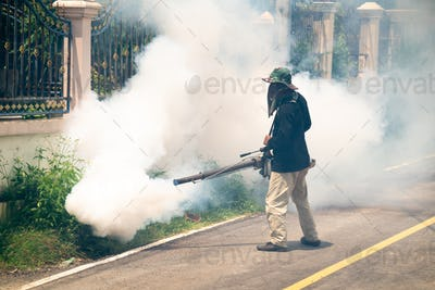man use fumigation mosquitoes machine for kill mosquito carrier of Zika virus and dengue fever