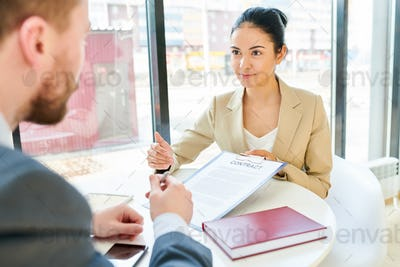 Businesswoman Showing Contract to Client