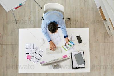Interior Designer Focused on Work