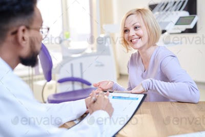 Smiling Young Woman Visiting Doctor