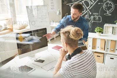 Two Creative Web Developers Working in Studio