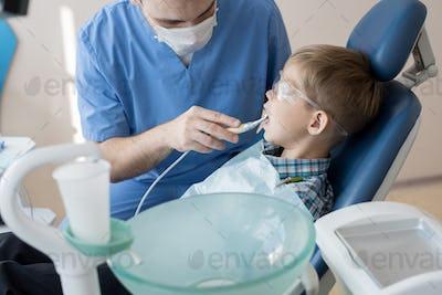Dentist Treating Little Kid