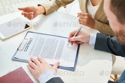 Unrecognizable Businessman Signing Contract Top View