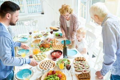 Happy Family Setting Table for Dinner