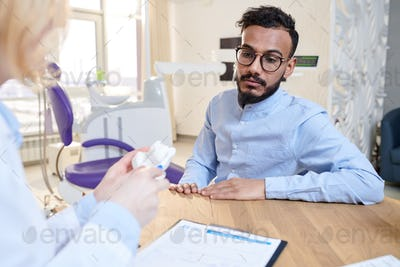 Middle-Eastern Man Listening to Doctor