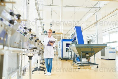 Pretty Worker Controlling Production Process