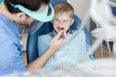 Little Boy Suffering from Toothache