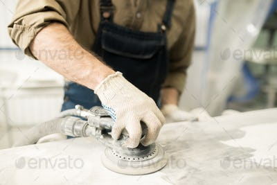 Technician Polishing Auto Part