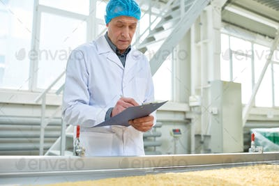 Senior Worker Overseeing Food Production
