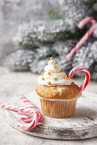 Christmas festive cupcake with candy cane